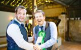 Two men in suits wearing Green Rosette