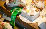 Green Rosette on the table of a Cake Baking Competition